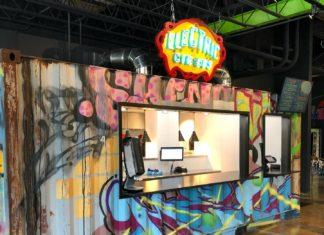 Precarious Beer Hall food stand serving tacos and nachos from an indoor converted shipping container featuring colorful street-style graffiti