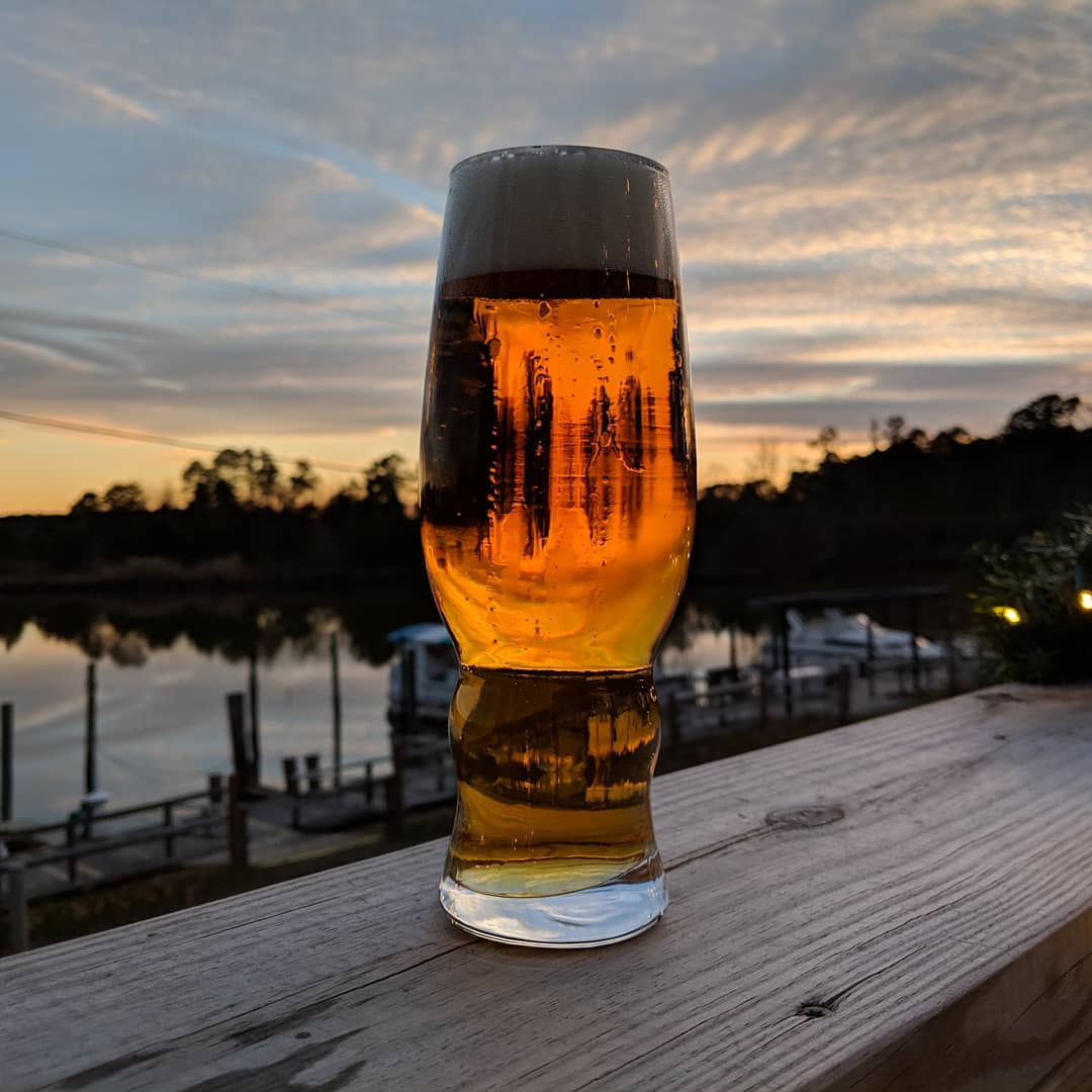 Billsburg brewery fly away spa sunset on the deck at the marina in James city county williamsburg virginia